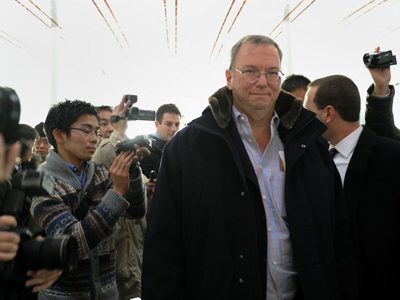 Google Executive Chairman Eric Schmidt (C) makes his way after checking in at Beijing International airport in Beijing on January 7, 2013, before his trip to North Korea. (Wang Zhao)