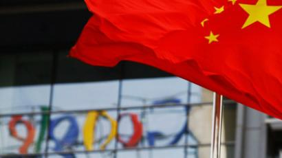 The Google logo is reflected in windows of the company's China head office as the Chinese national flag flies in the wind in Beijing (AFP Photo/Li Xin)