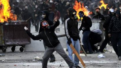 Masked demonstrators in Athens on October 20, 2011 (AFP Photo / Louisa Gouliamaki)