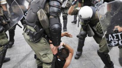 Police beats a detained demonstrator during a demonstration marking the 24-hours general strike on October 5, 2011 (AFP Photo / Louisa Gouliamaki)
