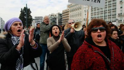 Health workers shout slogans during an anti-austerity rally in front of the parliament in Athens February 23, 2012 (Reuters / John Kolesidis)