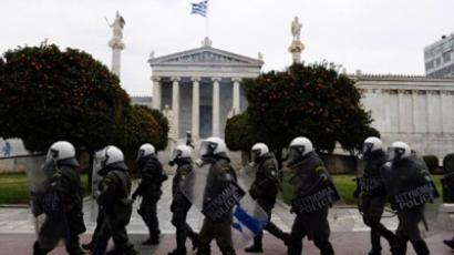 Anti-riot policemen walk in front of the Athens' University during a 48-hour general strike on February 10, 2012. (AFP Photo / Louisa Gouliamaki)