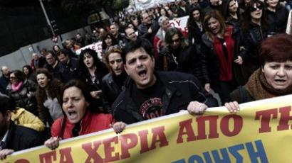 Health workers shout slogans during a demonstration against the government's austerity measures in central Athens on February 23, 2012 (AFP Photo / Aris Messinis)