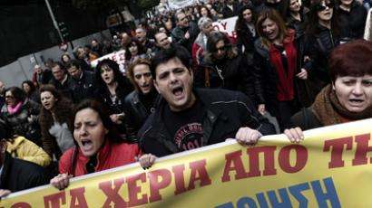 Health workers shout slogans during a demonstration against the government's austerity measures in central Athens on February 23, 2012 as Greek parliament met to approve laws needed for a historic debt write down with private creditors, a key condition for a new eurozone bailout designed to avoid default. (AFP Photo/Aris Messinis)