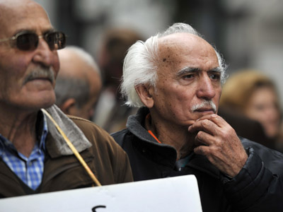 Greek pensioners attend a march in central Athens , protesting new austerity cuts  (AFP Photo/Louisa Gouliamaki)
