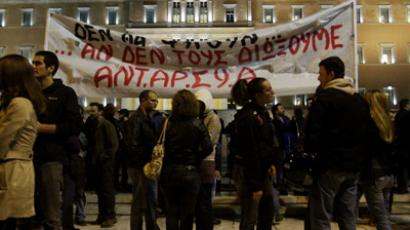 Demonstrators stand outside the Greek Parliament protesting against austerity measures in Athens on November 11, 2012 (AFP Photo / Panayiotis Tzamaros)