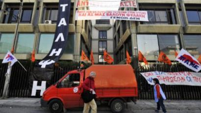 Members of the Public Power Corporation and PAME communist-affiliated unions occupy the company's billing department to stop it from sending emergency property tax demands to homeowners on November 21, 2011 in Athens (AFP Photo / Louisa Gouliamaki)