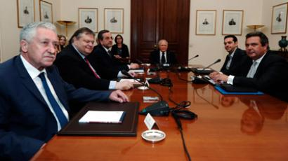 Greek political leaders (from L to R): Democratic Left party leader Fotis Kouvelis, Socialist PASOK party leader Evangelos Venizelos, Conservative New Democracy party leader Antonis Samaras, Greek President Karolos Papoulias, head of Greece's Left Coalition party Alexis Tsipras and leader of the Independent Greeks party Panos Kammenos meet at the presidential palace in Athens May 15, 2012 (Reuters/Aris Messinis/Pool)