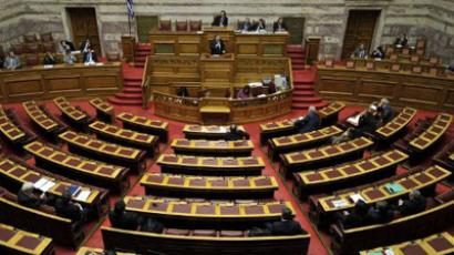 Greek Parliament has been charged with pushing through yet more austerity legislation in order for the country to receive the cash from its second bailout package (AFP Photo/ Louisa Gouliamaki)