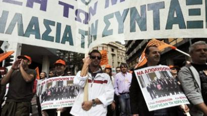 Municipal workers protest in central Athens on October 11, 2011 carrying posters featuring a picture of the Greek government and reading 'fire them now-they led the country to disaster' (AFP Photo / LOUISA GOULIAMAKI)