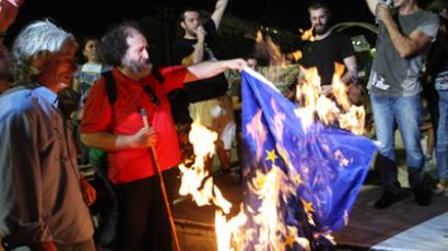 Demonstrators burn a European flag during a protest against budget cuts on 8 September, 2012 in Thessaloniki. (AFP Photo/Sakis Mitrolidis)