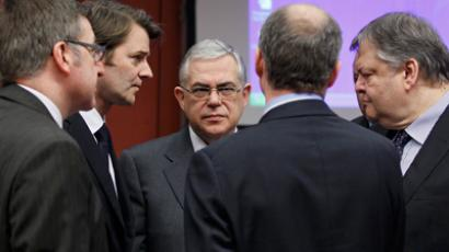 Steven Vanackere (L), Francois Baroin (2nd L), Lucas Papademos (C) and Evangelos Venizelos (R) attend a Eurogroup meeting at the European Union council headquarters in Brussels February 20, 2012 (Reuters / Yves Herman)