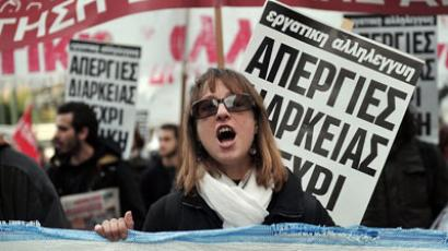 A woman shouts slogans while marching with others towards the Greek Parliament in Athens on December 19, 2012.(AFP Photo / Louisa Gouliamaki)