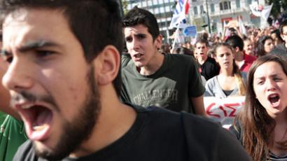 Protesters from the communist-affiliated trade union PAME march outside the parliament during a rally in central Athens November 6, 2012.  (Reuters/Costas Baltas)