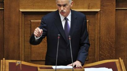 Greek Prime minister George Papandreou addressing the Greek Parliament at the opening of debate on a parliamentary vote of confidence in the new Greek cabinet on June 19, 2011 (AFP Photo / Louisa Gouliamaki)