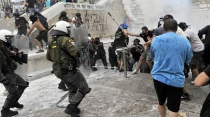 Police disperse demonstrators tyring to take refuge in the metro station at the occupied Sytagma square in front of the parliament in Athens on June 29, 2011 (AFP Photo / Louisa Gouliamaki)