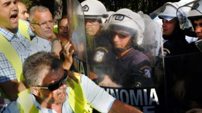 Greek policemen and members of police unions clash with riot police outside a riot police facility in Athens September 6, 2012. (Reuters/Yannis Behrakis)