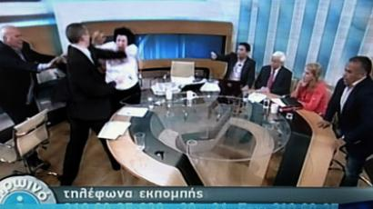 A picture taken on June 7, 2012 of Antena TV shows Golden Dawn Member of Parliament Ilias Kasidiaris (2ndL) hitting Liana Kanelli, a female MP for the Greek Communist party during a talk show on ANTENA TV station. (AFP Photo/ANTENA/TV out)
