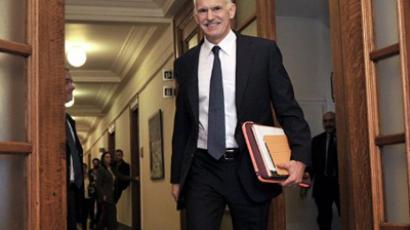 Greek Prime Minister George Papandreou proceeds for a cabinet meeting on November 3, 2011 in Athens (AFP Photo / LOUISA GOULIAMAKI)