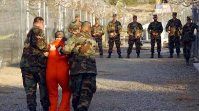 U.S. Army Military police escorting a detainee to his cell in Naval Base Guantanamo Bay (REUTERS/Stringer/Files)
