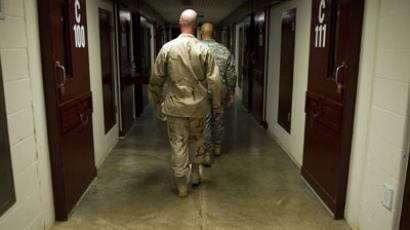 "This image reviewed by the US military shows members of the military walking the hallway of Cell Block C in the ""Camp Five"" detention facility of the Joint Detention Group at the US Naval Station in Guantanamo Bay, Cuba.(AFP Photo / Jim Watson)"
