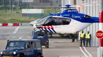A police helicopter leaves Rotterdam / The Hague Airport with Ratko Mladicon board on May 31, 2011 (AFP Photo / Marcel Antonisse)