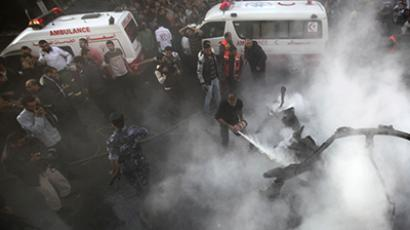Palestinians extinguish the fire after an Israeli air strike on a car in Gaza City November 14, 2012. (Reuters)