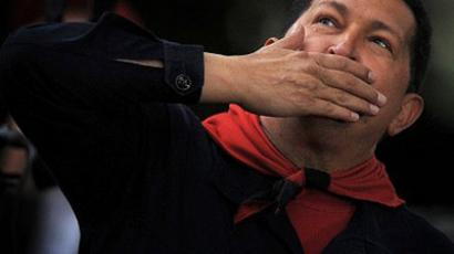 Venezuelan President Hugo Chavez blowing kisses to supporters during the commemoration of the ninth anniversary of the failed coup against him, in Caracas on April 13, 2011. (AFP Photo/Juan Barreto)