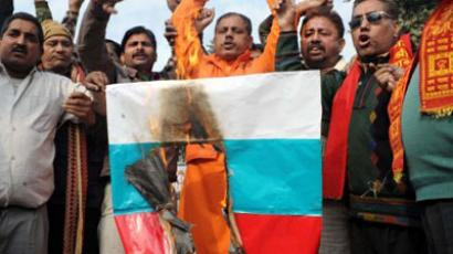 Indian activists of the right-wing Hindu organisation Shiv Sena shout-slogans as they burns a Russian flag during a protest against Russia in Amritsar on December 26, 2011 (AFP Photo / NARINDER NANU)