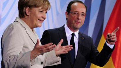 German Chancellor Angela Merkel (L) and the new French president Francois Hollande gesture after addressing a press conference at the German Chancellery on May 15, 2012 in Berlin (AFP Photo / J. Macdougal)