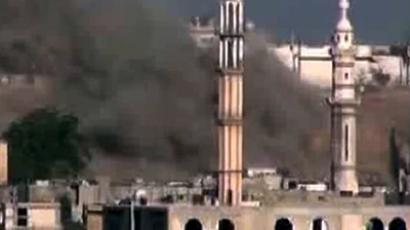 Smoke billowing from a mosque in the Talbeesa neighbourhood of the restive central city of Homs (AFP Photo / Youtube)