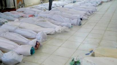 The bodies of whom anti-government protesters say were killed by government security forces lie on the ground at Ali Bin Al Hussein mosque in Huola, near Homs May 26, 2012 (Reuters/Houla News Network/Handout)