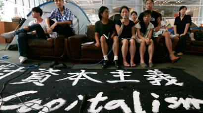 Protesters from Occupy Hong Kong hold a news conference at HSBC headquarters in Hong Kong (Reuters / Siu Chiu)