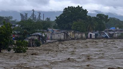 Heavy rains from Hurricane Sandy causes the Croix de Mission river to swell to levels that threaten to flood the homes along its bank in Port-au-Prince October 25, 2012. (Reuters / Swoan Parker)