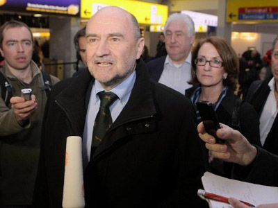 International Atomic Energy Agency chief inspector Herman Nackaerts (C) speaks to the press as he arrives at the Vienna airport before boarding a plane to Iran, on February 19, 2012. (AFP Photo / Dieter Nagl)