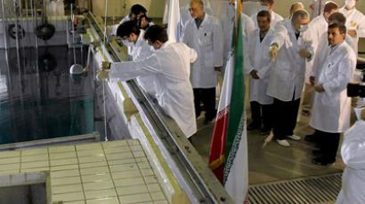 A handout picture released by Iranian President Mahmoud Ahmadinejad's official website shows him (R) listening to an expert during a tour of Tehran's research reactor centre on February 15, 2012 . (AFP Photo/Iranian Presicency)