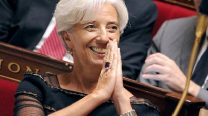 Paris: French Finance and Economy Minister Christine Lagarde reacts during her ovation by French MP's as part of the weekly session of questions to the government, on June 29, 2011. (AFP Photo / Bertrand Guay)