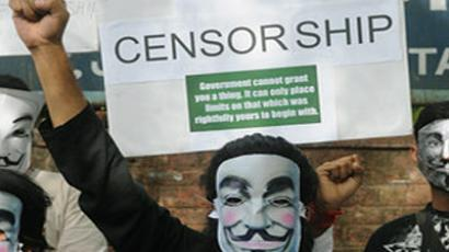 Activists supporting the group Anonymous wear masks as they protest against the Indian Government's increasingly restrictive regulation of the internet in New Delhi on June 9, 2012. (AFP Photo/Raveendran)