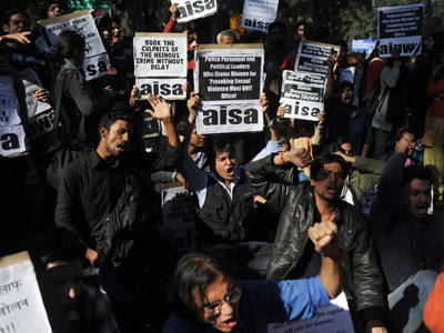 Indian activists shout slogans outside Delhi's chief minister residence during a protest in New Delhi on December 19, 2012.(AFP Photo / Sajjad Hussain)