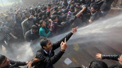 Demonstrators shout slogans as police use water cannons to disperse them near the presidential palace during a protest rally in New Delhi December 22, 2012 (Reuters / Adnan Abidi)