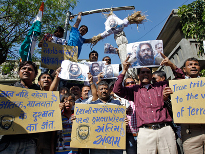 Demonstrators carry placards and posters and an effigy depicting Mohammad Afzal Guru during celebrations in the western Indian city of Ahmedabad February 9, 2013 (Reuters /Amit Dave)