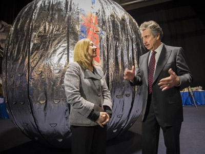 This NASA photo shows NASA Deputy Administrator Lori Garver and President and founder of Bigelow Aerospace Robert T. Bigelow as they talk while standing next to the Bigelow Expandable Activity Module (BEAM) during a media briefing where it was announced that the BEAM expandable space habitat technology will be tested on the International Space Station on January 16, 2013 in Las Vegas, Nevada. (AFP Photo/NASA)