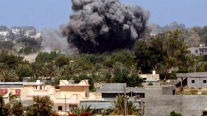 Smoke billows from Tajura, a suburb of the Libyan capital Tripoli, on June 25, 2011 as three powerful explosions struck the eastern suburb, the site of a number of military installations (AFP Photo / Mahmud Turkia)