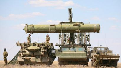 Troops prepare the anti-aircraft missile system S-300V to detect and destroy air targets at the tactical training exercises of Air Defense Forces in the Western military district (ZVO) at Kapustin Yar. (RIA Novosti/Kirill Braga)