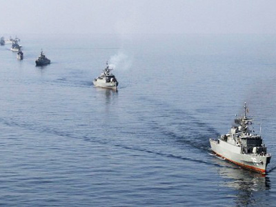 "Iranian Navy boats take part in maneuvers during the ""Velayat-90"" navy exercises in the Strait of Hormuz in southern Iran (AFP Photo / EBRAHIM NOROOZI)"