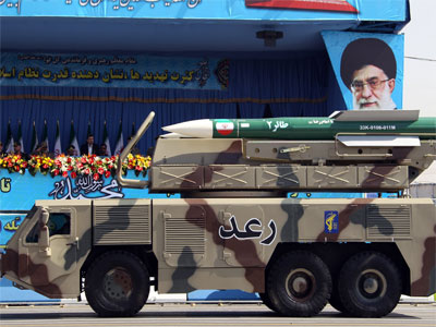 A picture dated September 21, 2012, shows a Raad air defense system carrying Taer missiles being displayed by Iran's Revolutionary Guard, during an annual military parade which marks Iran's eight-year war with Iraq, in the capital Tehran. Iranian forces have carried out what they called cyber warfare tactics for the first time as the Islamic republic's naval units staged manoeuvres in the key Strait of Hormuz, media reports said on December 31, 2012.(AFP Photo / Atta Kenare)