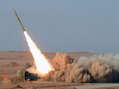 In a picture obtained from Iran's ISNA news agency on July 3, 2012, shows AN Iranian short-range missile (Fateh) launched during the second day of military exercises, codenamed Great Prophet-7, for Iran's elite Revolutionary Guards at an undisclosed location in Iran's Kavir Desert. (AFP Photo/ISNA/Arash Kyamoushi)
