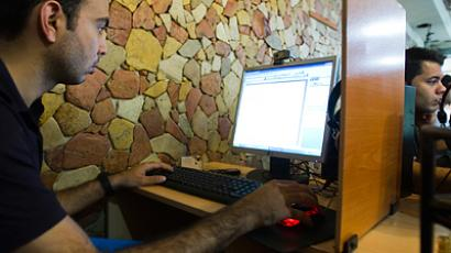 A customer uses a computer at an internet cafe in Tehran (Reutes / Raheb Homavandi)