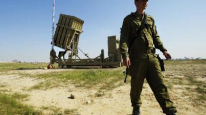 "An Israeli soldier stands next to a launcher, part of the first ""Iron Dome"" missile defense system deployed in Israel, near the southern city of Beer Sheva (AFP Photo / David Buimovitch)"