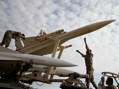Iranian soldiers prepare to launch a Hawk surface-to-air missile during military maneuvers. (AFP Photo / Amin Khoroshahi)